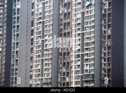 Tianjin, China. 17th Aug, 2015. Tianjin Explosion aftermath.Apartment buildings overlooking the port show the blast - Stock Image