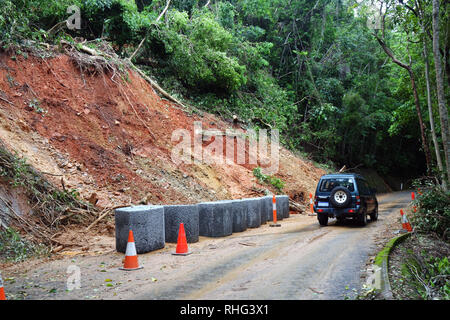 Landslip beside road due to wet season rains, Crystal Cascades Road, Redlynch, Cairns, Queensland, Australia. No PR - Stock Image