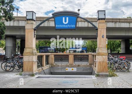 Berlin Dahlem District,Breitenbachplatz U-Bahn underground railway station entrance with old stone pillars, lamps & blue station name. - Stock Image