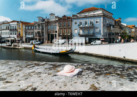 Portuguese delicacy called Ovos Moles made of egg yolks and sugar on the water channel background in Aveiro city, Portugal. - Stock Image