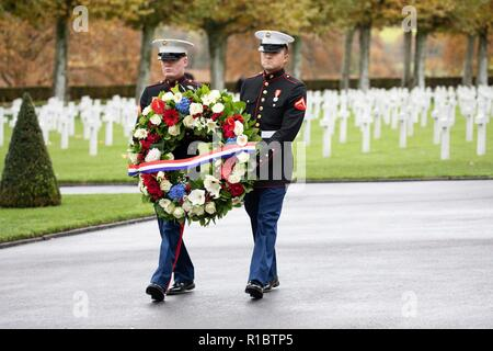 U.S Marines present a wreath during a ceremony at the Aisne - Marne American Cemetery near the World War One battle ground of Belleau Wood November 10, 2018 in Belleau, France. President Donald Trump was scheduled to attend the ceremony but cancelled due to inclement weather. - Stock Image