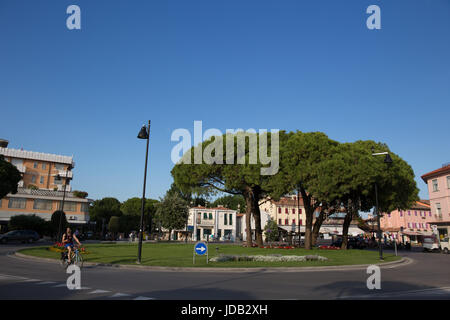 Roundabout with decorative flowers in the center of the city. Caorle, Italy - Stock Image
