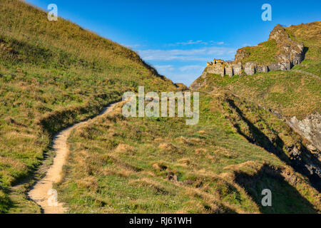 The south West Coast Path as it approaches Tintagel Castle, Cornwall, UK - Stock Image