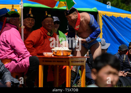 Naadam Festival in Khatgal, Mongolia. the winner receives the cheese - Stock Image