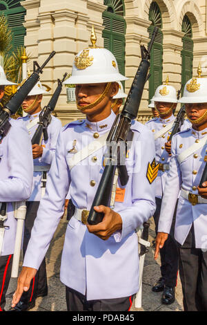 Bangkok, Thailand - 30th November 2014: Palace guard marching. The guard changes frequently, - Stock Image