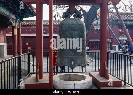 Bell in Yonghe Temple also called Lama Temple of the Gelug school of Tibetan Buddhism in Dongcheng District, Beijing, China - Stock Image