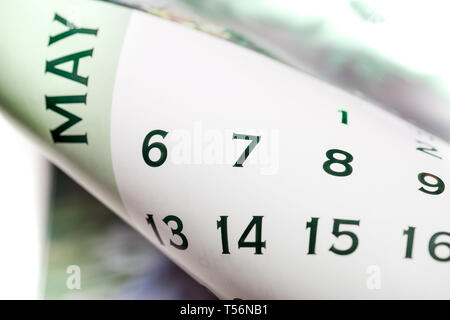 Curved May month calendar page. Numbers 8 and 9 in fosus - Stock Image