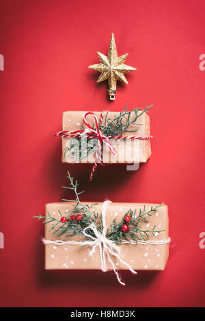 Christmas gift box on red background - Stock Image