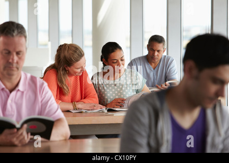 Mature students in class - Stock Image