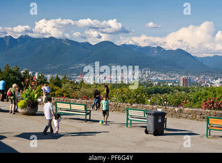 Queen Elizabeth Park in Vancouver, BC Canada.  People observing the scenic view of the city and mountains. - Stock Image
