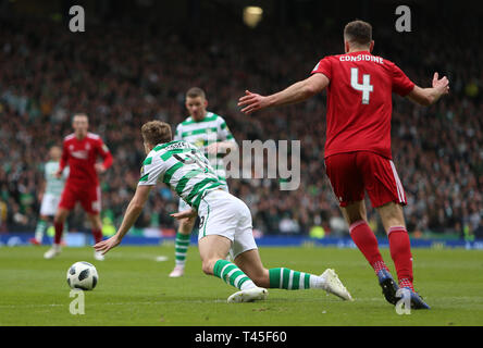 Hampden Park, Glasgow, UK. 14th Apr, 2019. Scottish Cup football, semi final, Aberdeen versus Celtic; Andrew Considine of Aberdeen holds back James Forrest of Celtic who goes down under the challenge Credit: Action Plus Sports/Alamy Live News - Stock Image