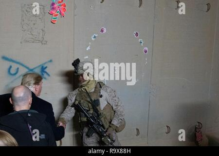 U.S. President Donald Trump greets a soldier on pulling security during a surprise visit to Al Asad Air Base December 26, 2018 in Al Anbar, Iraq. The president and the first lady spent about three hours on Boxing Day at Al Asad, located in western Iraq, their first trip to visit troops overseas since taking office. - Stock Image
