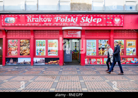 Swindon, Wiltshire, UK. 19th February, 2019. On the day that Honda has confirmed that they will be closing their car factory in the town two men are pictured walking past a Polish grocery shop in the town centre. Swindon was one of the first areas to declare a Leave result in the 2016 EU referendum. Many in the local community are worried that the job losses at Honda will have a catastrophic impact on the town. Credit: Lynchpics/Alamy Live News - Stock Image