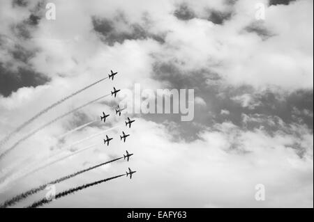 Red Arrows flying display at Malta International Airshow 2014, phoenix formation - Stock Image