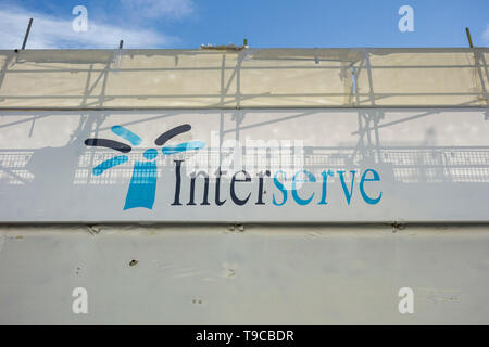 Interserve signage outside redevelopment on Berwick Street, Soho, London, UK - Stock Image