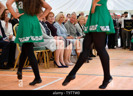 The Prince of Wales and the Duchess of Cornwall watches Irish dancers during their visit Glencree Peace and Reconciliation Centre in Glencree, Co Wicklow, on the first day of the Royal couple's visit to Ireland. - Stock Image