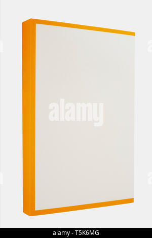 White book with yellow spine isolated on white background - Stock Image