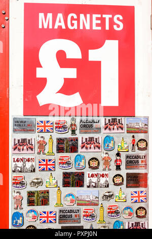 London England United Kingdom Great Britain Piccadilly Mayfair shopping souvenir shop store refrigerator magnets sterling pound sign iconic UK images - Stock Image