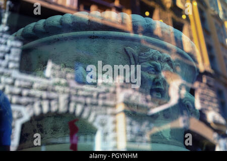 Abstract reflection of buildings and bas-reliefs of the old city of Riga in glass - Stock Image
