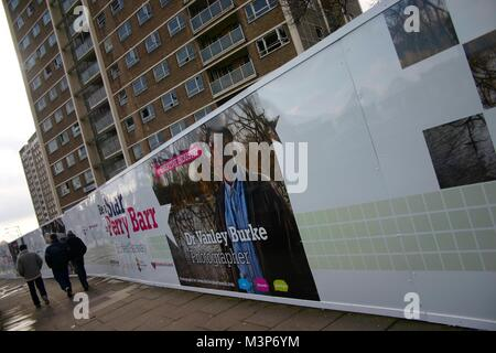 Street hoardings in Perry Barr Birmingham, UK, near proposed site of Commonwealth Games. - Stock Image