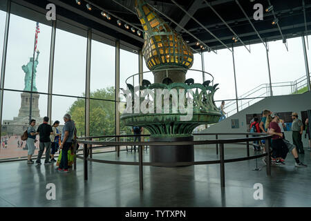 The Statue of Liberty's original torch is the focal point of a large room in the Statue of Liberty Museum that opened in May 2019 on Liberty Island. - Stock Image