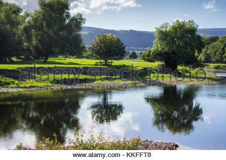 Reflections of trees in the River Usk at The Bryn, Llanvihangel Gobion, Monmouthshire, Wales, UK - Stock Image