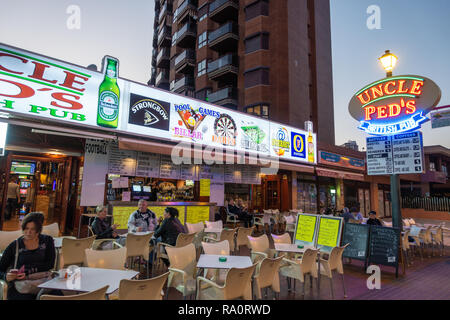 Uncle Ped's British Pub at dusk in the New Town, Benidorm, Alicante Province, Spain. - Stock Image