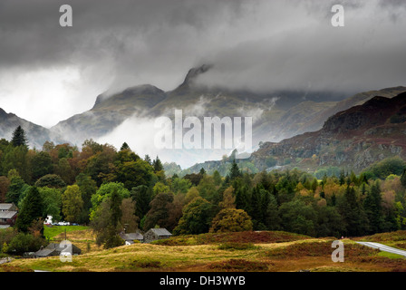 Overcast Low mist and clouds shrouding Langdale pikes in Cumbria - Stock Image