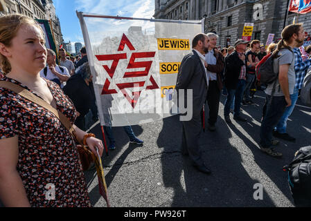 London, UK. 13th October 2018.    People and the Jewish Socialist Group banner at the rally in London to oppose racism  and fascism close to where the racist, Islamophobic DFLA were ending their march on Whitehall bringing together various groups to stand in solidarity with the communities the DFLA attacks. The event was organised by Stand Up To Racism and Unite Against Fascism. Peter Marshall/Alamy Live News - Stock Image