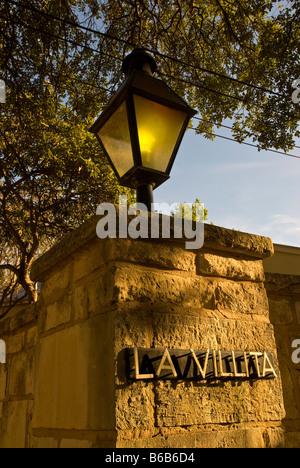 La Villita entrance sign street lamp stone wall historic arts village san Antonio texas tx tourist attraction shopping - Stock Image