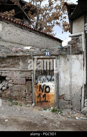 Door in Ankara, Turkey, with number 11 written on it - Stock Image