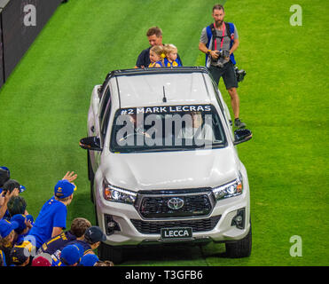 West Coast Eagles retiring  footballer Mark Lecras and children on the back of a Toyota vehicle lap of honour Optus Stadium Perth WA Australia. - Stock Image