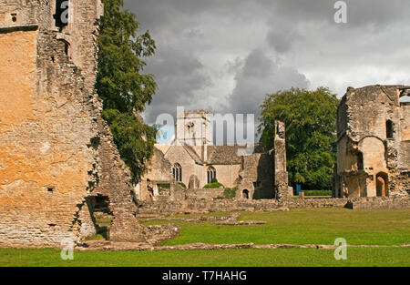 Minster Lovell Hall ruins and Church Cotswolds Oxfordshire. So named after St Kenelm's Minster, the village church. - Stock Image