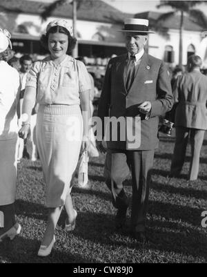 Mollie Cullum with Edward R. Bradley, Hialeah Racetrack,, 1938 - Stock Image
