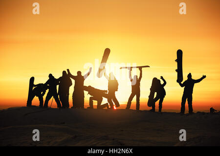 Group happy ski snowboard skiing snowboarding concept - Stock Image