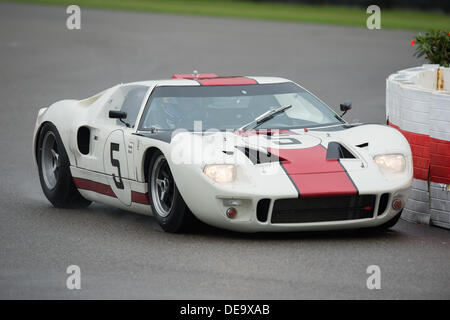 Chichester, West Sussex, UK. 13th Sep, 2013. Goodwood Revival. Goodwood Racing Circuit, West Sussex - Friday 13th September. Racing action on the track with the GT-40 qualifying session. Adrian Newey of Red Bull Racing driving car no 5. © MeonStock/Alamy Live News - Stock Image