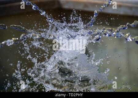 water explodes in a close up image (actually imploding) - Stock Image