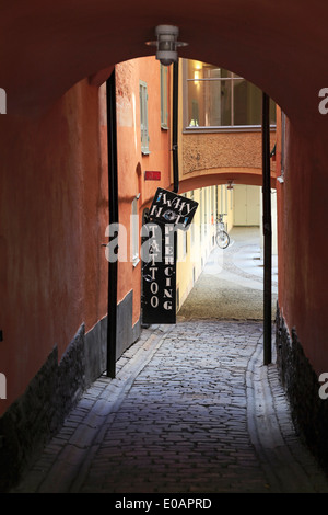 Old town, Stockholm. Narrow alley with cobble stones. - Stock Image