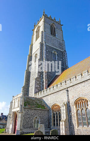A view of the magnificent tower of the parish Church of the Holy Trinity and All Saints at Winterton-on-Sea, Norfolk, England, United Kingdom, Europe. - Stock Image