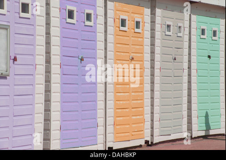 Beach huts on the promenade at Lyme Regis, Dorset, England - Stock Image