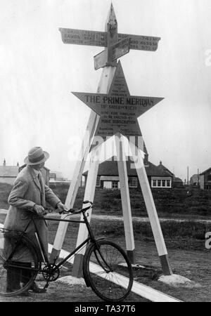 Statue of the Prime Meridian in London's Greenwich district, 1934. Above it the distance to cities worldwide. - Stock Image