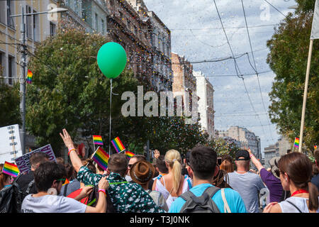 BELGRADE, SERBIA - SEPTEMBER 17, 2017:  Crowd raising and holding rainbow gay flags during the Belgrade Gay Pride. The parade happened this year witho - Stock Image