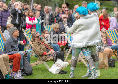 Bournemouth, UK. 30th September 2018. The Arts by the Sea Festival is underway with all manner of colourful street performances, art, dance and music in the centre of Bournemouth. Crowds enjoy Bab's and Stella's Intergalactic Spectacular. Credit: Thomas Faull/Alamy Live News - Stock Image
