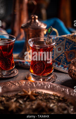 Black Turkish tea in traditional glasses - Stock Image