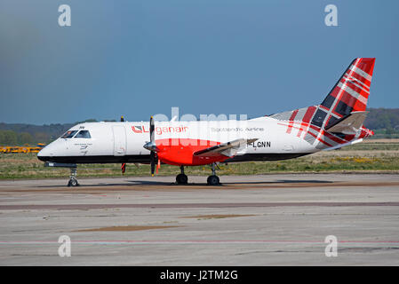 Inverness airport, Scotland, UK. 1st of May, 2017. Arrival of the new Loganair Saab 340B in its new tartan livery - Stock Image