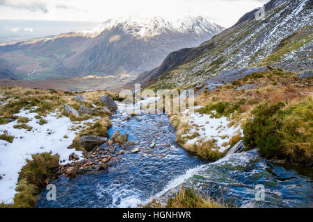 Mountain stream from Nameless Cwm (Cneifion) above Cwm Idwal in Snowdonia National Park in winter. Ogwen, Wales, - Stock Image