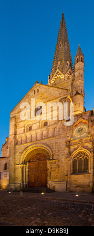 North entrance to Autun Cathedral showing astronomical clock and gothic spire with evening light and floodlights - Stock Image