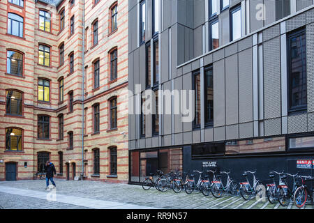 Mitte-Berlin. Inner Courtyard with old brick building facade and modern exterior. Old & New - Stock Image