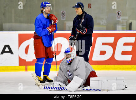 Bratislava, Slovakia. 12th May, 2019. L-R Czech ice hockey player Petr Zamorsky, Pavel Francouz and Goalkeeper's Coach Zdenek Orct are seen during a training session of the Czech national team within the 2019 IIHF World Championship in Bratislava, Slovakia, on May 12, 2019, one day prior to the match against Russia. Credit: Vit Simanek/CTK Photo/Alamy Live News - Stock Image