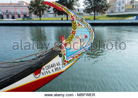 Aveiro is renown for its canals and canal boats called Moliceiro. They are colourfully painted and often have risque images painted on the front - Stock Image